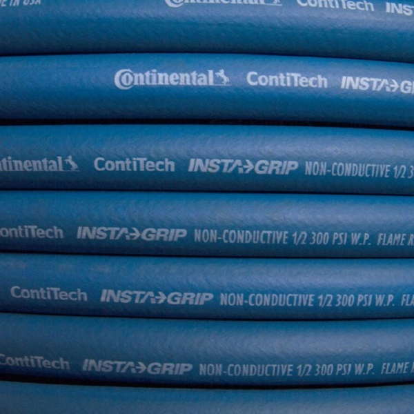 Close-up of a coil of blue Continental ContiTech Instagrip hose.