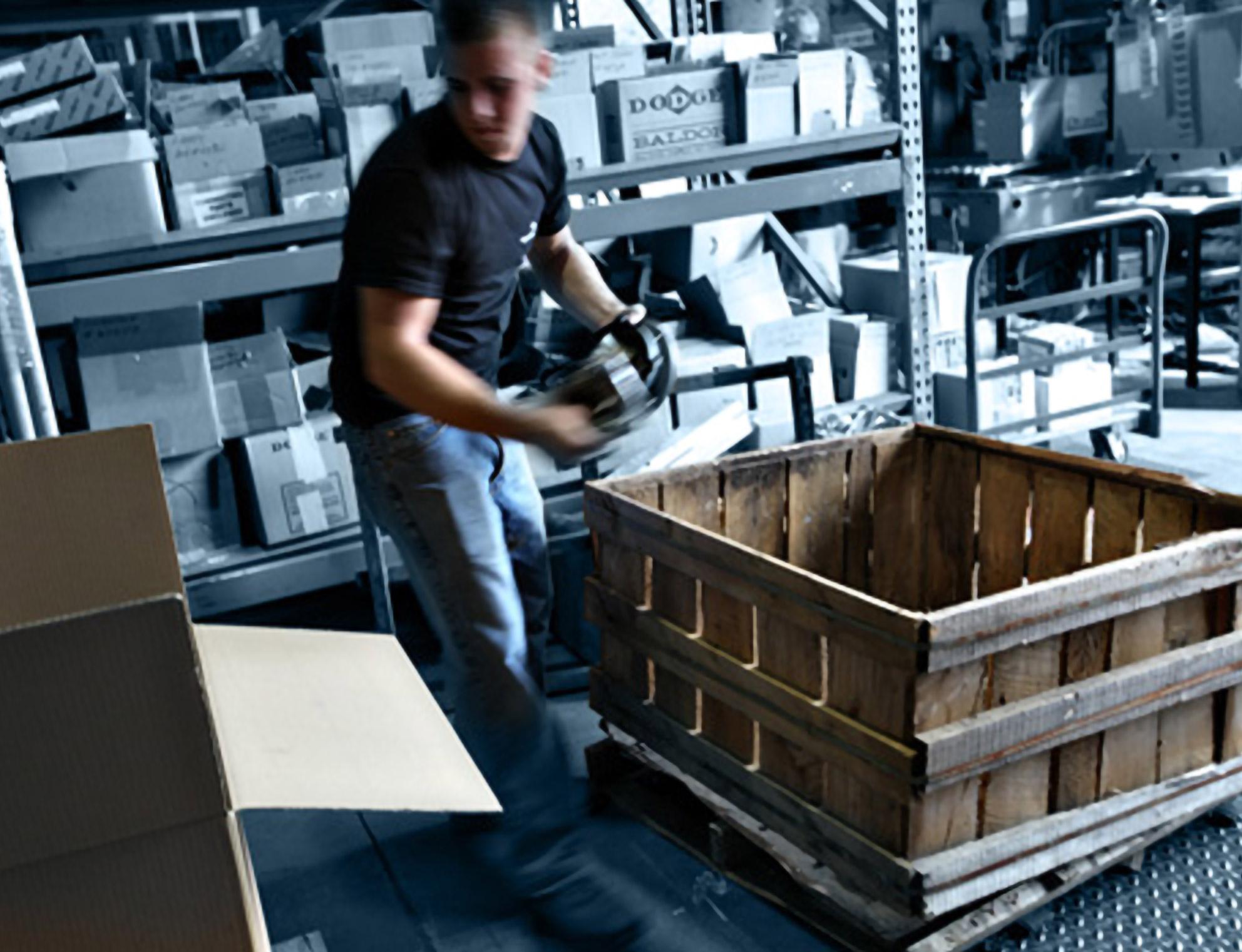 Binkelman employee sorting industrial components.