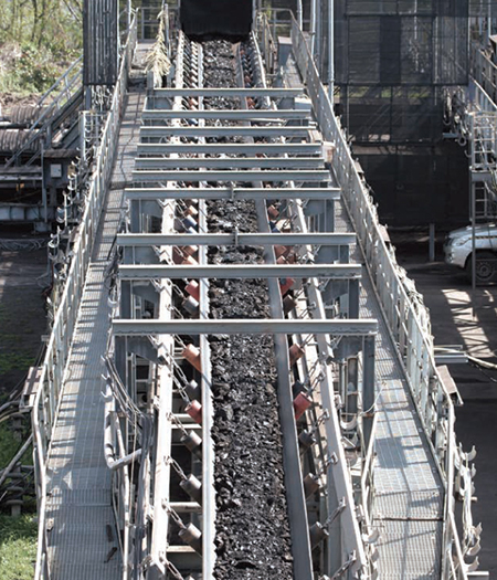 Large conveyor belt moving material.